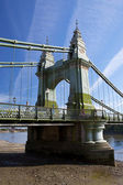 Hammersmith Bridge is a suspension bridge which crosses the River Thames in West London — Stock Photo