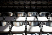 Rows of folding metal chairs — Stock Photo