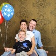 Happy family with coloured balloons — Stock Photo