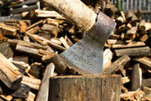 Firewood and ax — Stock Photo