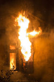 Residential home on fire, fully involved — Stock Photo