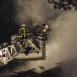 Firefighters at work — Stock Photo
