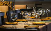 Fine restaurant dinner table place setting: napkin & wineglass — Stock Photo