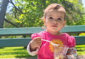 Little Girl Eating Icecream Outdoor — Stock Photo