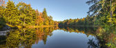Panorama of a forest lake in fall — Stock Photo