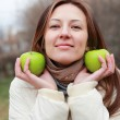Stock Photo: Girl and green apples
