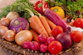 Basket full of fresh vegetables — Stock Photo