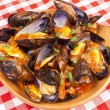 Steamed mussels with marinara sauce — Stock Photo