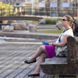 Reading on a bench — Stock Photo