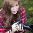 Stock Photo: Teenage with camera