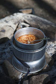 Baked beans on Camping Kitchen — Stock Photo
