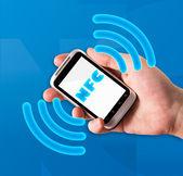Smartphone with near field communication technology — Stock Photo