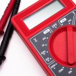Red digital multimeter isolated on white background — Stock Photo #26384097