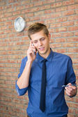 Young businessman talking on phone. Time concept in business — Stock Photo