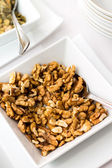 Walnuts in ceramic bowl on table — Photo