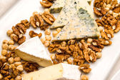 Cheese and walnuts on ceraminc dish.  — Stock Photo