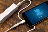 Phone charging with energy bank. — Stock Photo