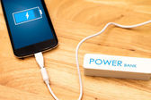 Phone charging with energy bank. — Stock Photo