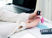 Woman paints the nails at work. concept of leisure time. — Stock Photo