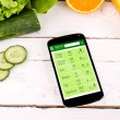 Counting calories in smartphone. Concept of app for healthcare — Stock Photo #47736791