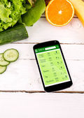 Counting calories in smartphone. Concept of app for healthcare — Stock Photo