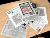 Newspaper and a cup of coffee — Stock Photo
