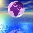 World globe above the ocean - Stock Photo