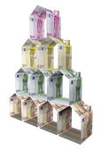 Houses made of euro paper money — Stock Photo