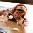 Cleaning: Woman Finds Keys Under Couch — Stock Photo