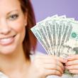 CSR: Holding Up a Money Fan — Stock Photo