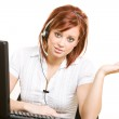 CSR: Woman at Desk with Headset — Stock Photo