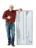 Check: Man Stands Next to Huge Bank Check — Stock Photo