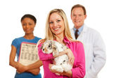 Veterinarian: Customer Holds Rabbit with Vet Behind — Stock Photo