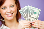 CSR: Holding Up a Money Fan — Stock Photo
