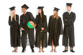 Graduation: Graduates Look Over at Funny Guy — Stock Photo