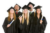 Graduation: Group of Graduates with Diplomas Look Upwards — Stock Photo