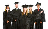 Graduation: Excited Girl with other Graduates Behind — Stock Photo