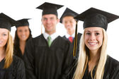 Graduation: Proud Girl Leads Group of Graduates — Stock Photo