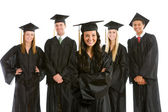 Graduation: Pretty Female Graduate with Others Behind — Stock Photo