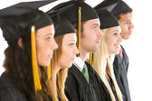 Graduation: Group of Graduates Look to the Side — Stock Photo