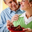 Couple: Eating a Piece of Chocolate Cake — Stock Photo