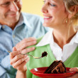Couple: Eating a Piece of Chocolate Cake — Stock Photo #24213757