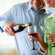Couple: Having a Glass of Red Wine — Stock Photo
