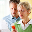 Couple: Man and Woman Concerned About Prescription — Stock Photo
