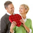 Couple: Heart Shaped Candy Box for Valentine's Day Holiday — Stock Photo