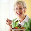 Couple: Woman Having a Green Salad — Stock Photo #24214963