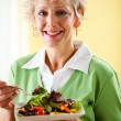 Couple: Woman Having a Green Salad — Stock Photo