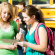 School Bus: Girl Not Impressed with Friend's Report Card — Stock Photo