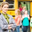 Stock Photo: School Bus: Stern Teacher At Bus Arrival
