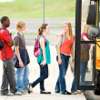School Bus: Line of Students Boarding Bus — Stockfoto